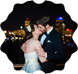 A Bride and Groom Kiss on the roof balcony of the Cambridge Hyatt Regency