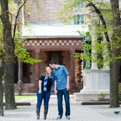 A cute couple poses for engagement photography in Copley Square Boston