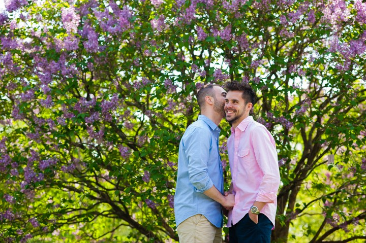 Couple in front of lilac bushes at Arnold Arboretum