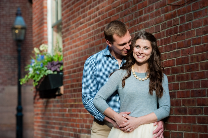 Adorable newly engaged couple poses in gorgeous natural light during their boston engagement session