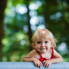 Toddler girl smiles during her portrait photography session at Carl Sandburg home