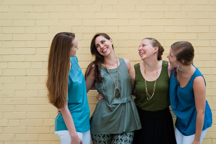 four ladies who are part of I Do wedding planning pose for a picture