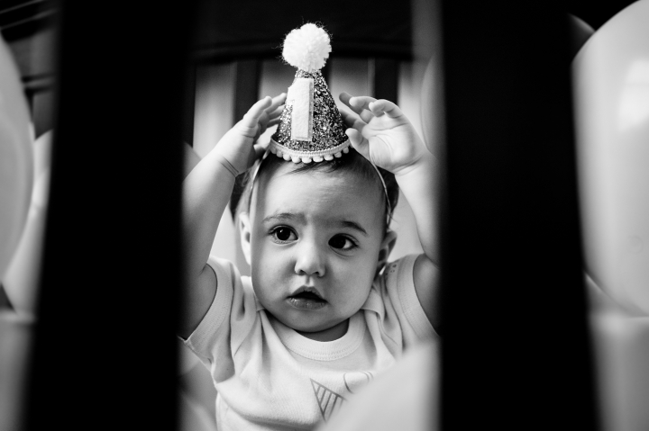 Adorable baby girl pulls her 1st year crown off her head during her 1st year birthday portrait session