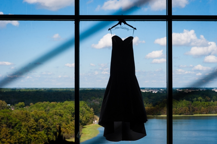silhouette of wedding dress hanging in Disney contemporary resort window