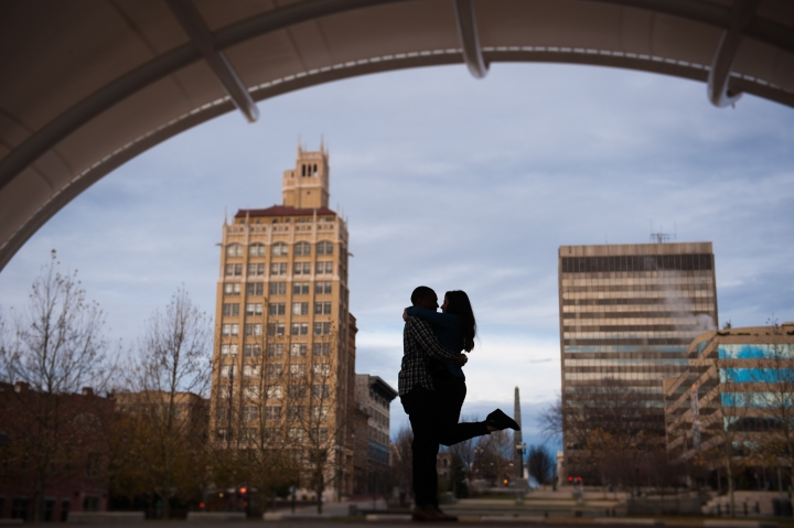 silhouette of newly engaged couple dancing at Asheville's downtown amphitheater