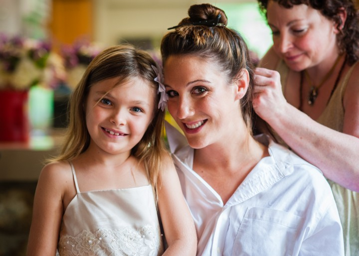 Bride and Flower Girl Posing for a Quick pictures during getting ready