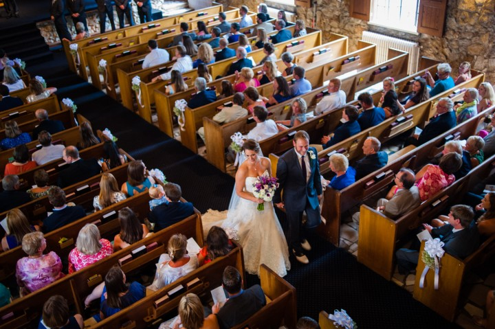 bride and groom walk down the Gaither Chapel aisle