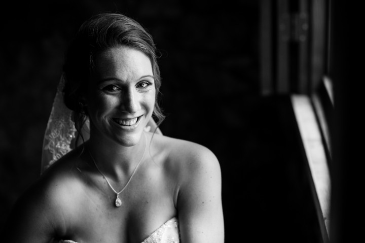 Bride poses for a moment before her ceremony at Gaither Chapel