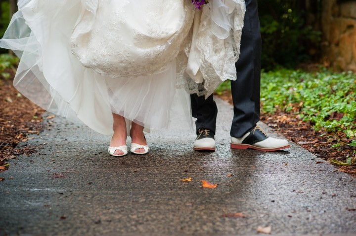 Bride and groom show off their shoes
