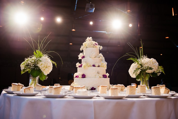 beautiful purple flowers on a traditional white wedding cake