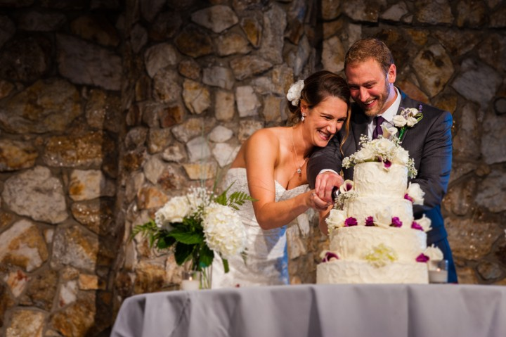 Bride and groom cut the cake at their montreat wedding reception