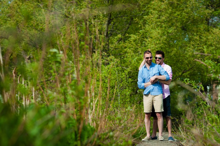 Sunglasses on and giving bunny ears during there Arnold Arboretum engagement session