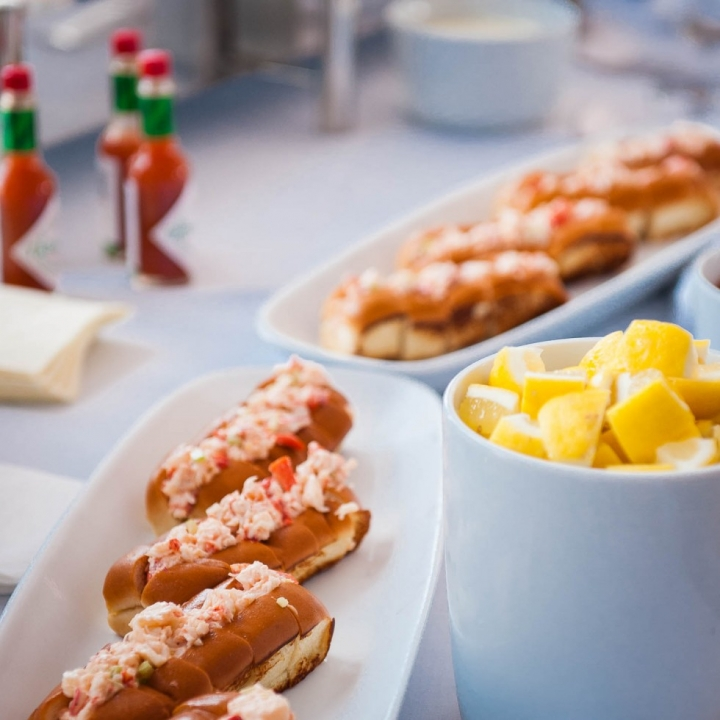 Plates of Lobster Rolls and Dishes of Lemon Wedges at a New Hapmshire Tented Wedding