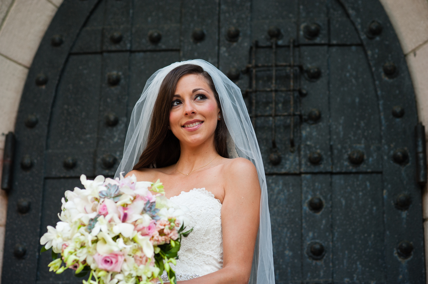Bride with her gorgeous bouquet poses for a quick portrait