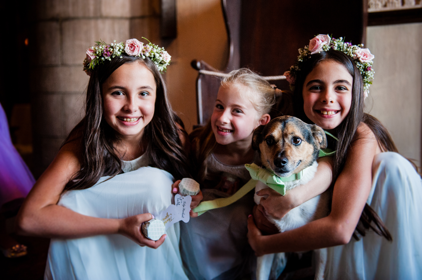 adorable flowers girls and the bride and grooms dog  smiling