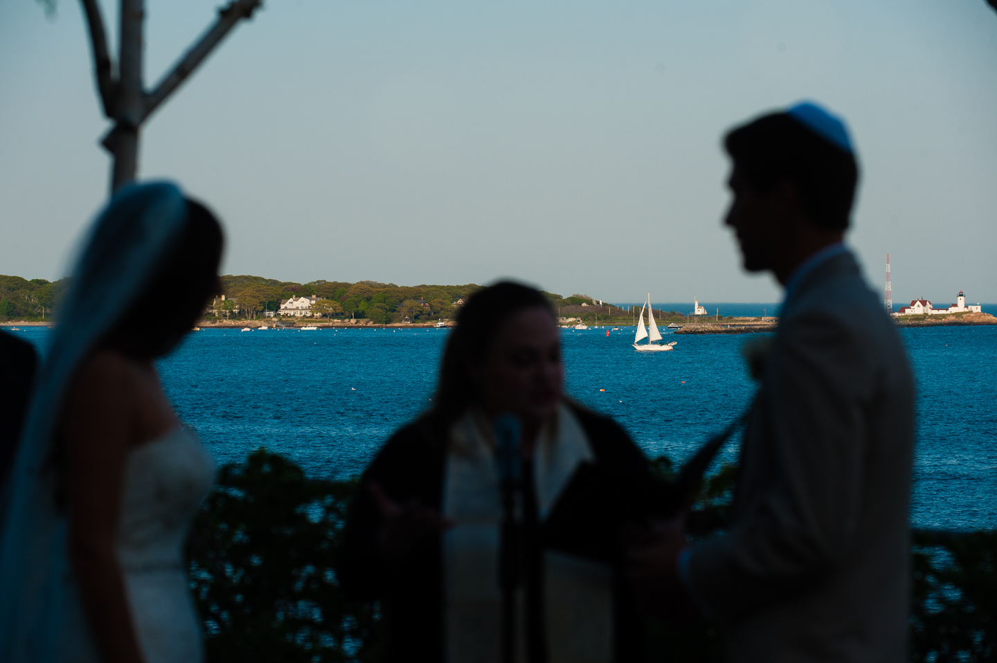 silhouette of bride and groom during their seaside wedding ceremony