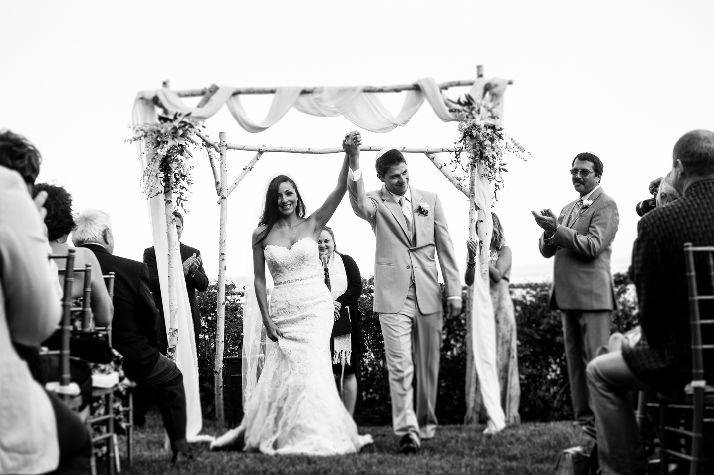 bride and groom happily walk down the aisle after their wedding ceremony at Hammond Castle