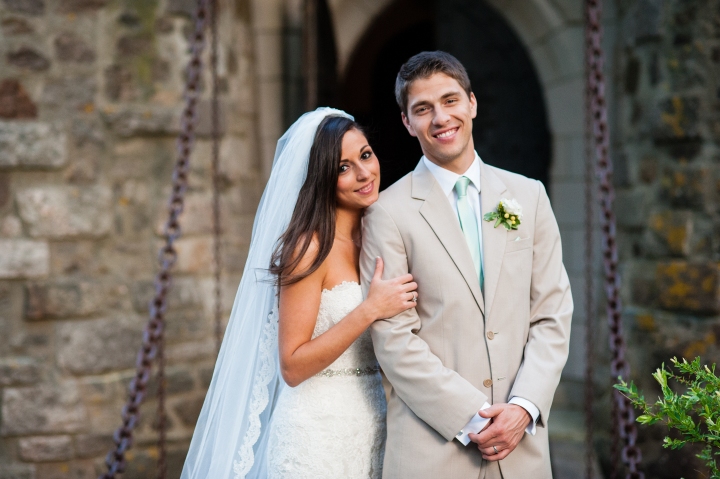 gorgeous bride and groom pose for a quick portrait after their wedding ceremony at hammond castle