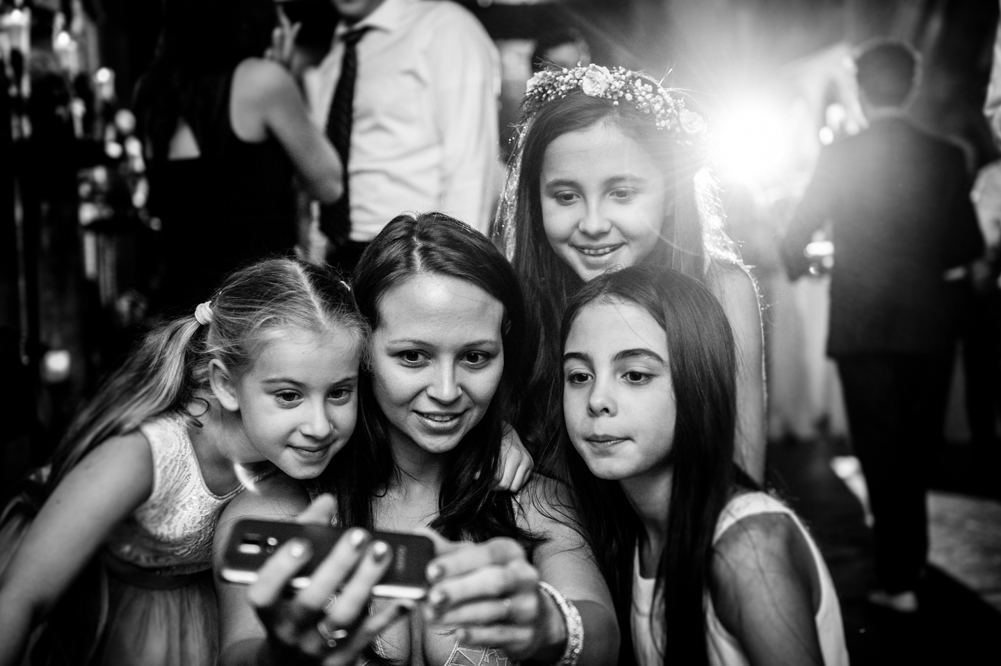 Flower girls and a guest take a self portrait during wedding reception at hammond castle