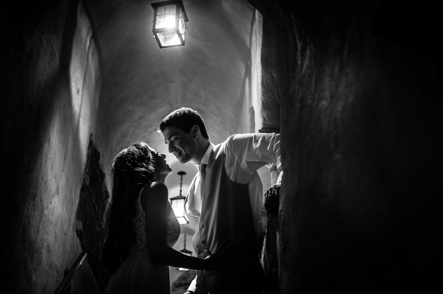bride and groom almost kiss in gorgeous spanish archway