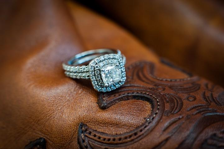 beautiful engagement ring on top of brides cowboy boot