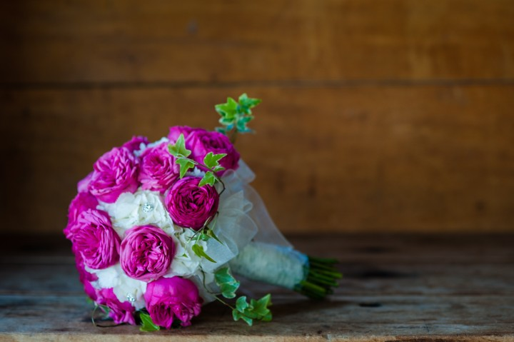 Gorgeous pink and white bridal bouquet for a rustic barn wedding