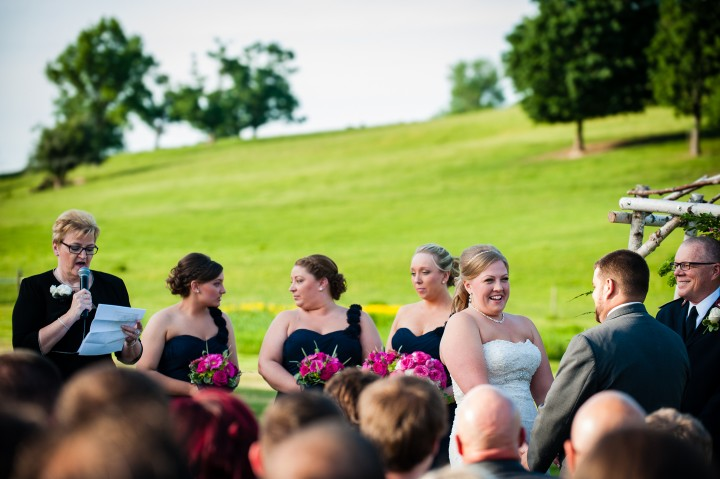 Bride laughs during her intimate and fun wedding ceremony