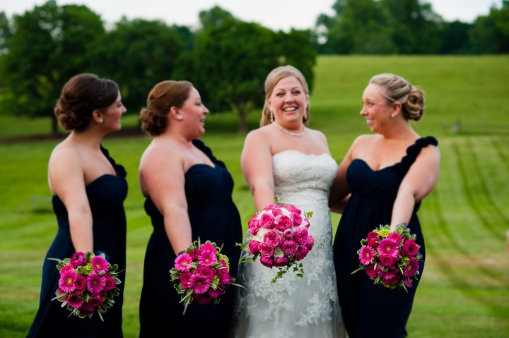 Gorgeous bride and her bridesmaids show of their gorgeous bouquets