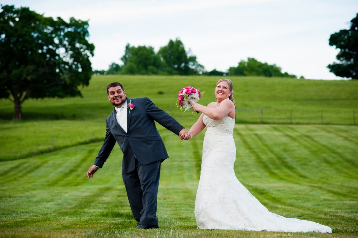 The adorable bride and groom goof off for a picture after their wedding ceremony at the Barn at Gibbet Hill