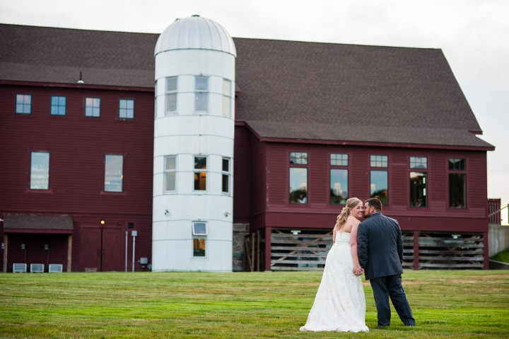 Adorable bride and groom pose for a picture at the Barn at Gibbet Hill