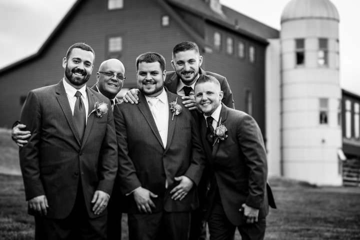 The groom and his groomsmen  pose for a quick portrait before the ceremony