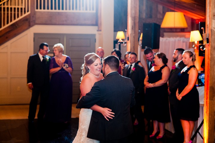 Adorable couple enjoys their first dance during their wedding at the Barn at Gibbet Hill