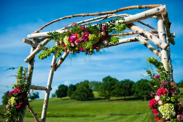 Beautiful birch arbor for a barn wedding ceremony