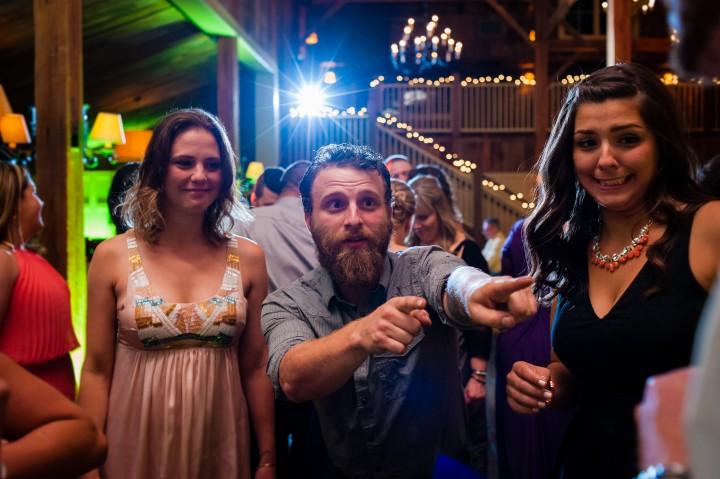 Wedding guests dancing during a fun barn wedding