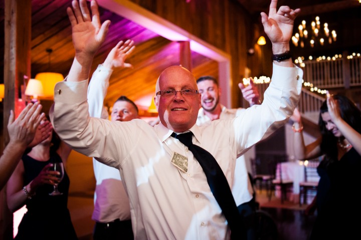 grooms dad dancing during his sons wedding at The Barn at Gibbet Hill