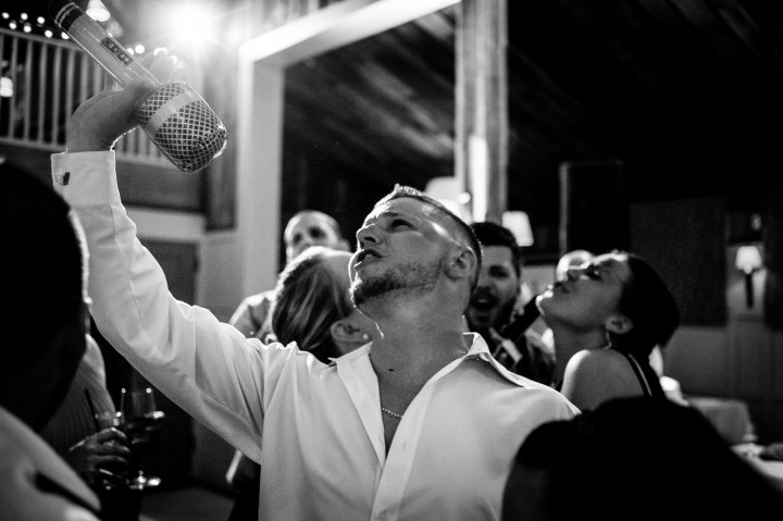 Wedding guest dances during a fabulous barn wedding