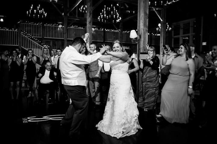 bride and groom dancing up a storm during the barn wedding reception