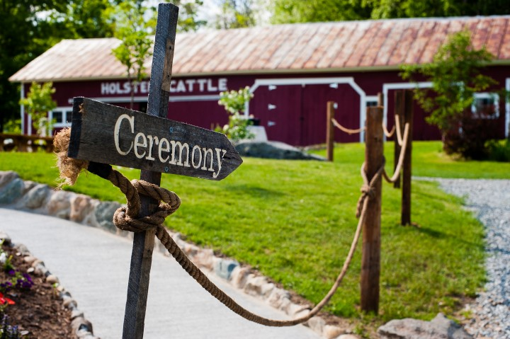 Handmade wooden ceremony sign directs guests where to go