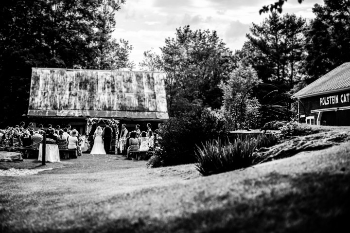 black and white image of a rustic outdoor ceremony