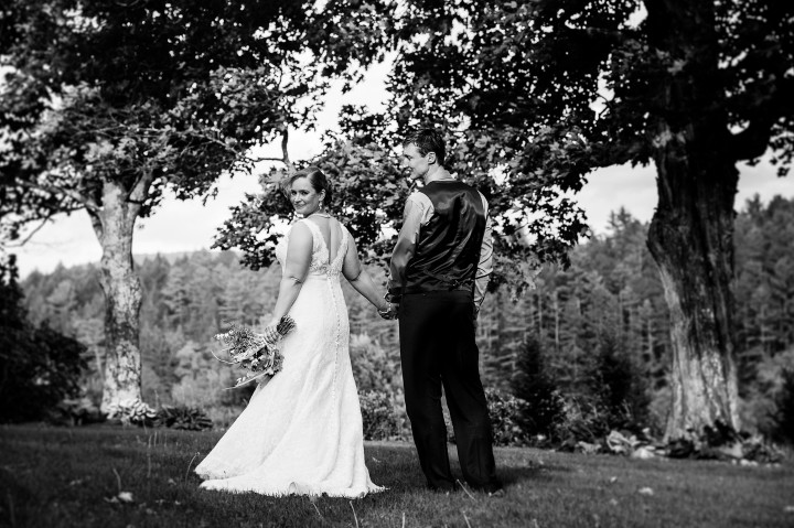 Beautiful bride looks back over her shoulder during a couples portrait