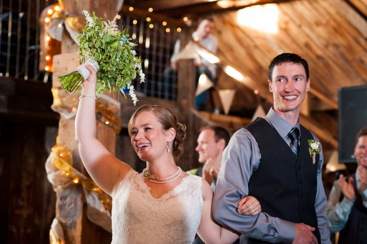 Jess and Paul happily enter the reception for their first dance