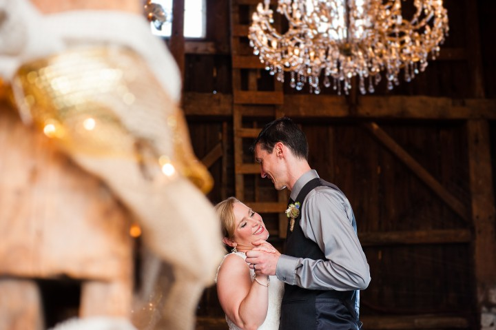 bride smiles during first dance during her beautiful  barn wedding