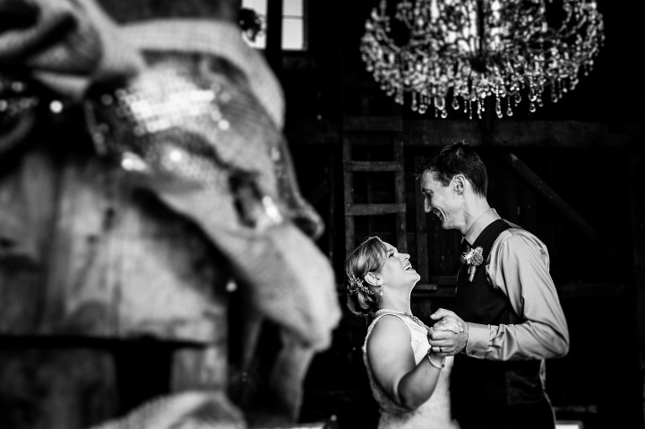 Bride and groom smile at each other during their first dance