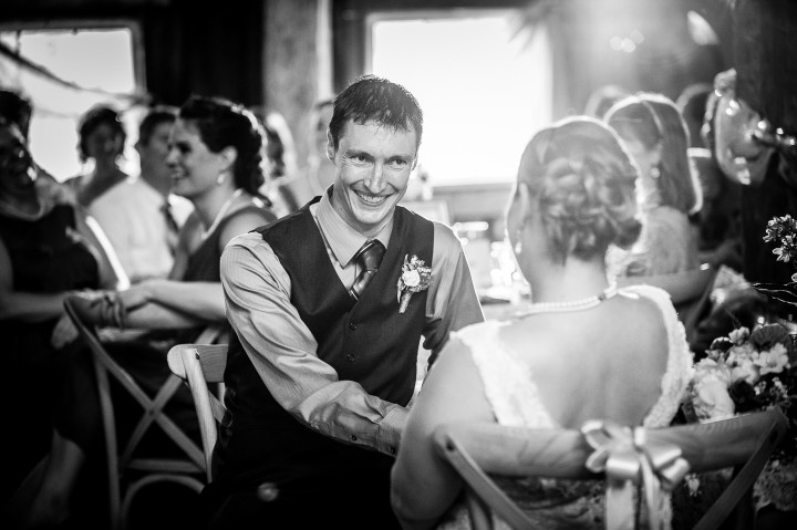 groom gives bride a sweet smile during a toast