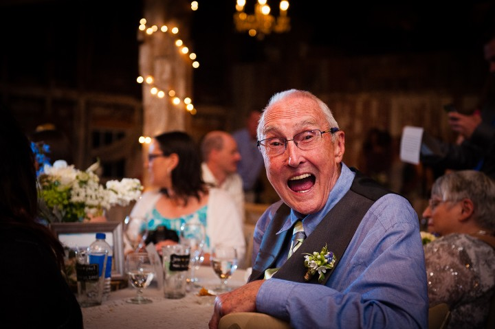 grooms dad being goofy during the wedding reception