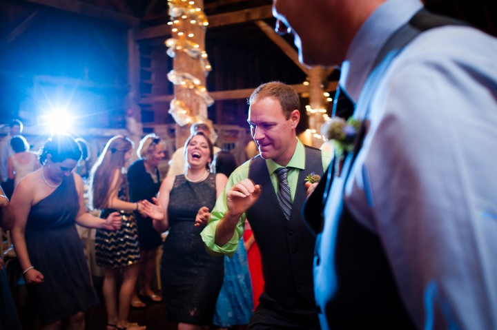 guests dancing during a wedding reception in the barn