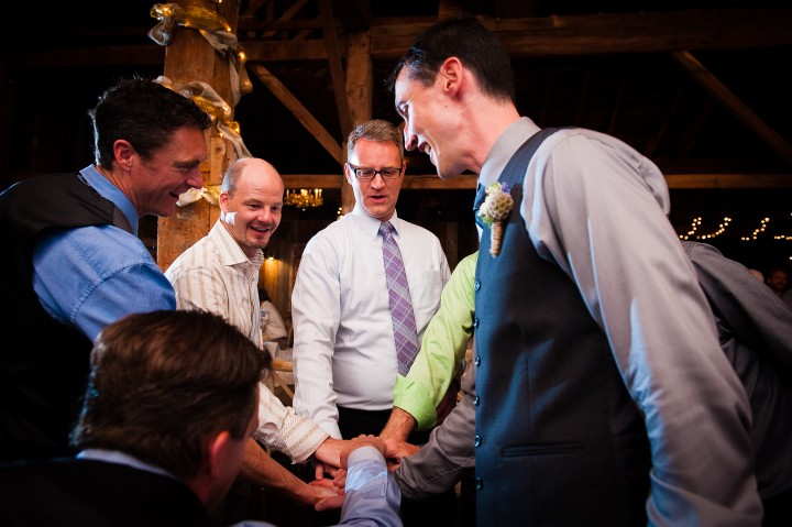 groom and his guys give each other low fives