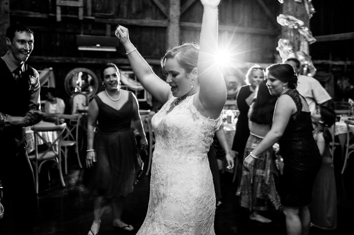 bride dances during her barn wedding reception