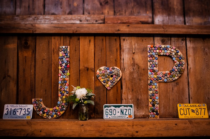 bride and groom made custom signs out of bottle caps with their initials