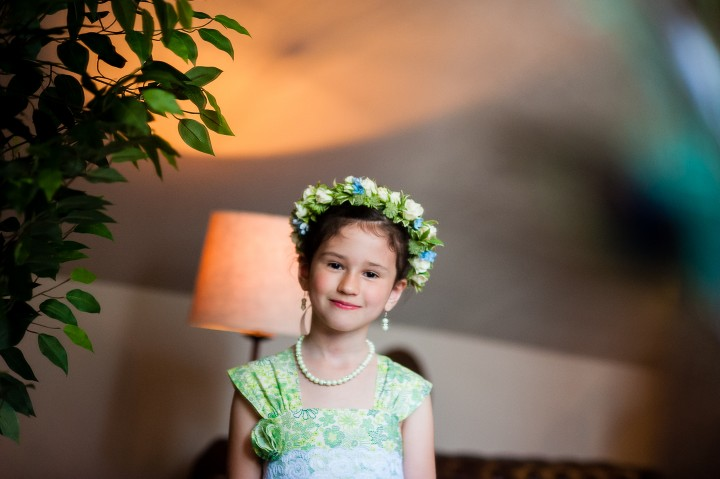 adorable flower girl with handmade flower girls dress smiles for a pictures